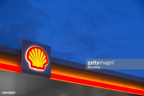 The Shell logo sits illuminated on a sign above the forecourt of a gas station operated by Royal Dutch Shell Plc in Moscow Russia on Tuesday Sept 30...