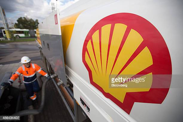 The Shell logo sits on a new fuel tanker truck as it delivers petrol to a gas station operated by Royal Dutch Shell Plc in Moscow Russia on Tuesday...