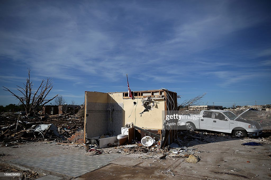 The shell of a bathroom is all the remains of a home damaged by a tornado June 2, 2013 in Moore, Oklahoma. Residents of Moore, Oklahoma continue to recover and sift through the remains of their homes two weeks after a devastating EF-5 tornado ripped through the town killing 24 people and destroying hundreds of homes and businesses.