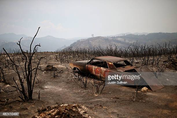 The shell of a car sits in an area charred by the Rocky Fire on July 30 2015 in Lower Lake California Over 600 firefighters are battling the Rocky...