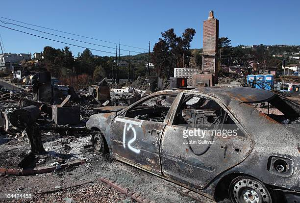 The shell of a car sits in the driveway of a burned home near the epicenter of the gas line explosion that devastated a neighborhood near San...