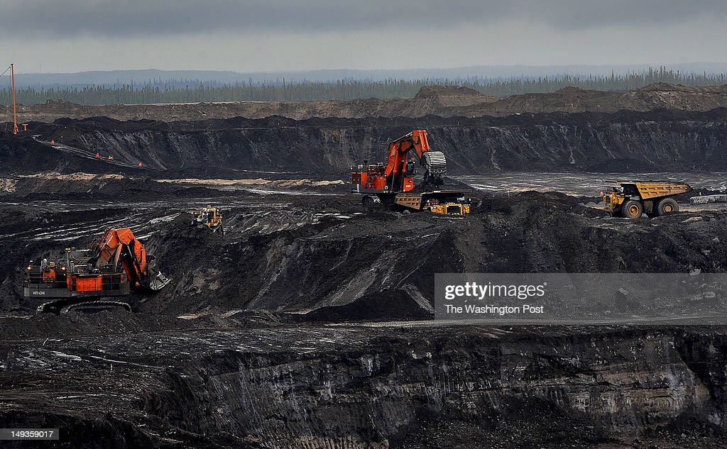 The Shell Oil Jackpine open pit mine uses trucks that are 3 stories tall weigh one million pounds and cost 7 million dollars each There is explosive...