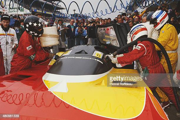 The Shell/Dunlop Porsche AG Porsche 962 C driven by Derek Bell and Hans Stuck makes a pit stop for fuel during the FIA World Sportscar Championship...