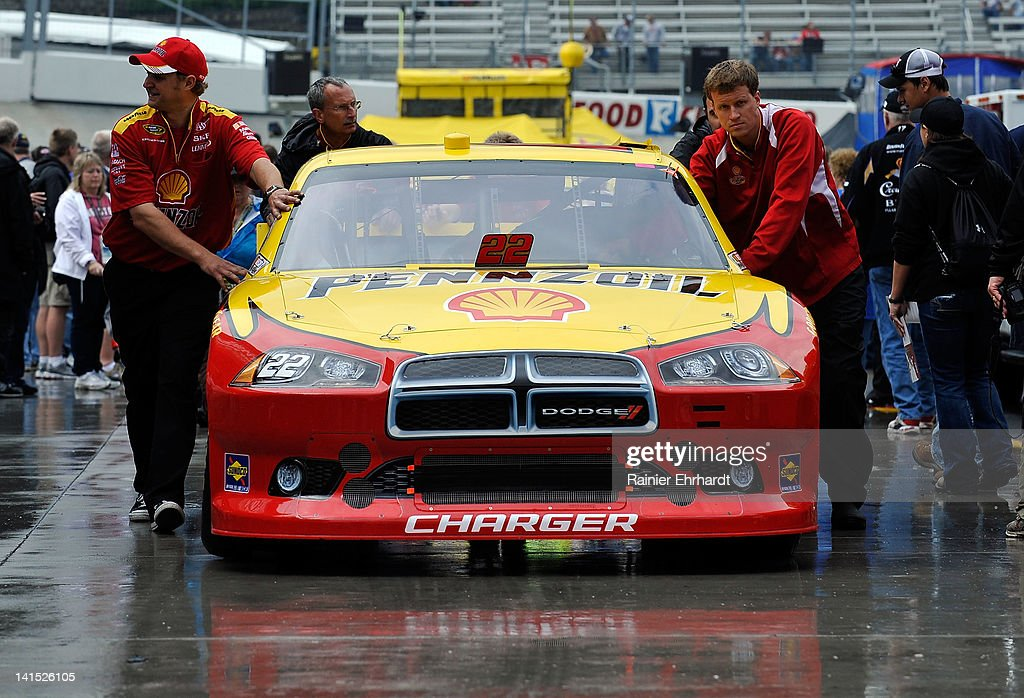 The #22 Shell/Pennzoil Dodge of A.J. Allmendinger is pushed through the wet garage area prior to the NASCAR Sprint Cup Series Food City 500 at Bristol Motor Speedway on March 18, 2012 in Bristol, Tennessee.