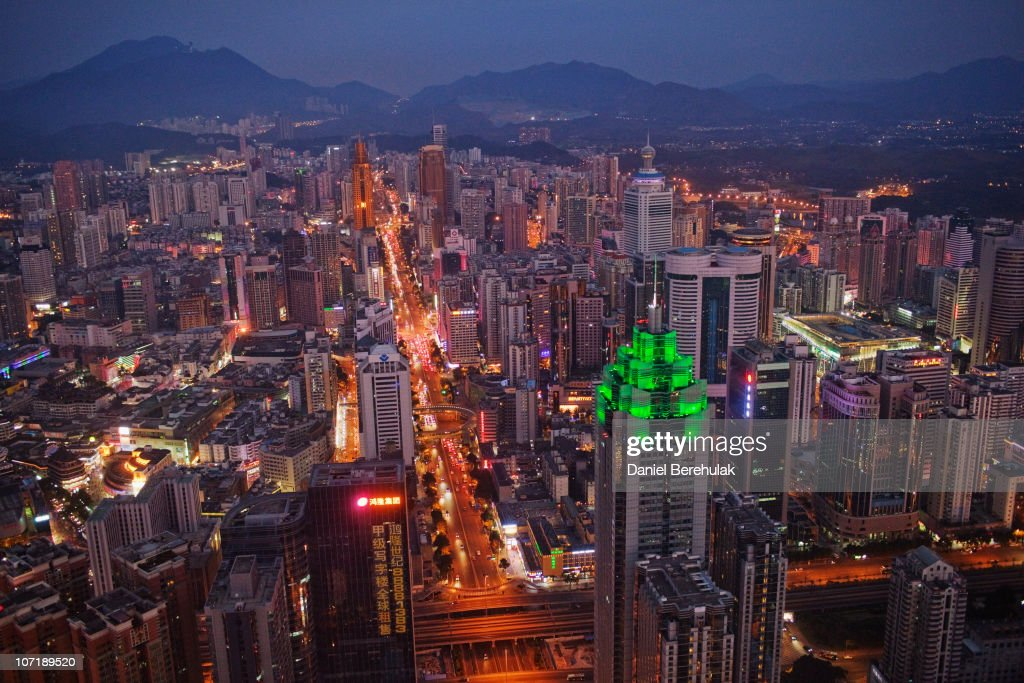 The Shenzhen skyline, including The Shenzhen World Financial Center, illuminated by green lights, stretches in to the distance on November 28, 2010 in Shenzhen, China. According to the US Commercial Service, Shenzhen is one of the fastest growing cities in the world. Home of the Shenzhen Stock Exchange and the headquarters of numerous technology companies, the now bustling former fishing village is considered southern China's major financial centre.