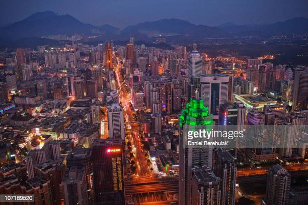 The Shenzhen skyline including The Shenzhen World Financial Center illuminated by green lights stretches in to the distance on November 28 2010 in...