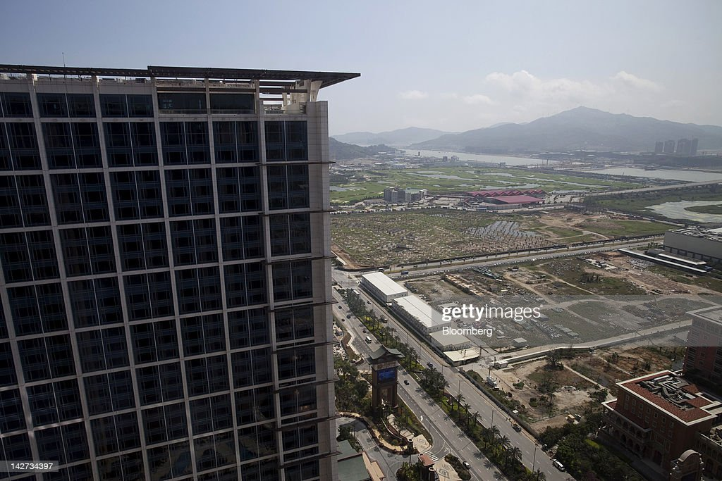 The Sheraton Macao hotel, left, part of the Sands Cotai Central casino resort, stands next to reserved land on the Cotai Strip in Macau, China, on Wednesday, April 11, 2012. Las Vegas Sands Corp. Chairman Sheldon Adelson plans to spend $35 billion on building Spanish gambling resorts over nine years and will add a new Macau location to expand globally. Photographer: Jerome Favre/Bloomberg via Getty Images