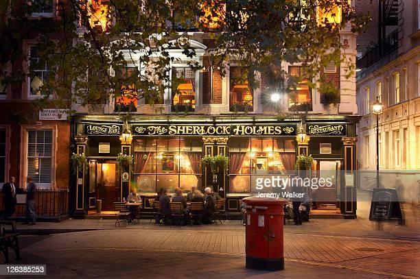 The Sherlock Holmes Pub illuminated at night in Northumberland street, London.