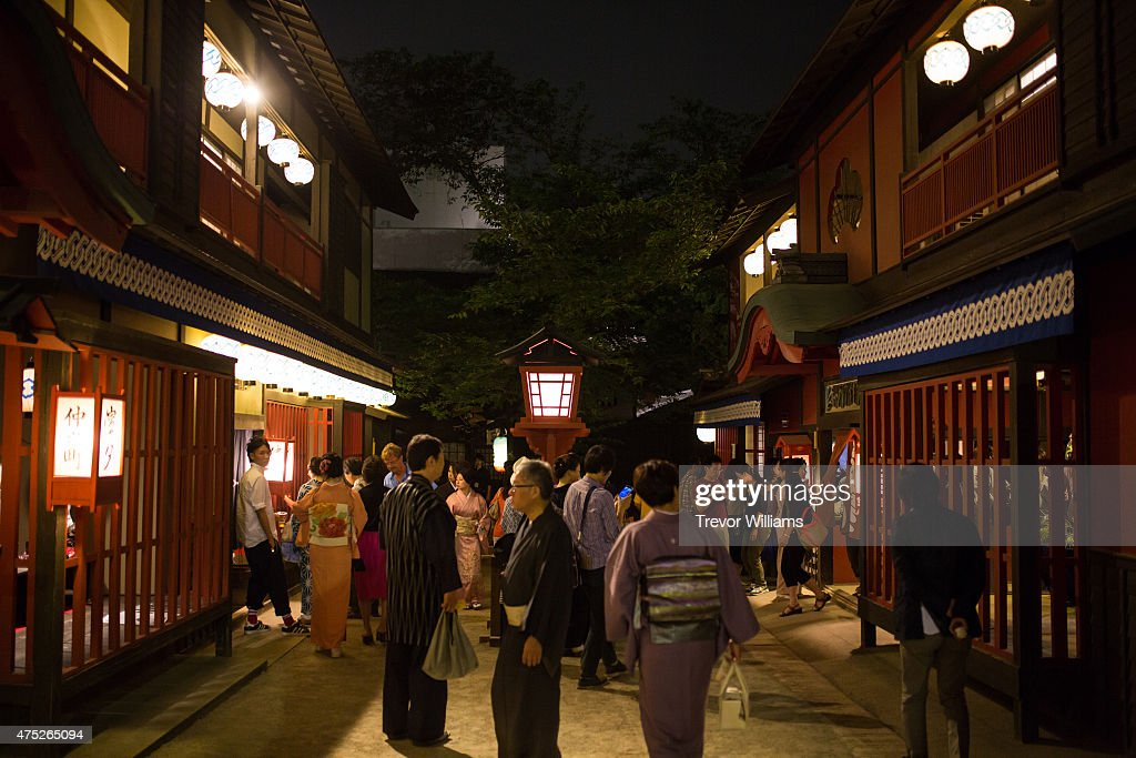 The Shimabara, or red light district, proved to be a popular place during the Uzumasa Edosakaba, an event recreating an edo-period bar at the Toei Kyoto Studio Park on May 30, 2015 in Kyoto, Japan. The Toei Kyoto Studio Park, a studio park built next to a working film set, turned itself into a big edo-period bar where people can drink and enjoy edo period culture including Japanese cuisine and samurai sword fighting.