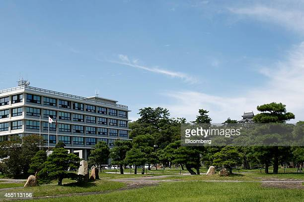 The Shimane Prefectural Office building left and the Matsue Castle right stand in Matsue Shimane Prefecture on Tuesday Sept 9 2014 In Matsue Japanese...
