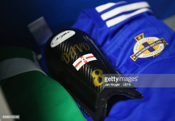 The shin guard worn by Steven Davis of Northern Ireland is seen in the dressing room prior to the UEFA EURO 2016 Group C match between Poland and...