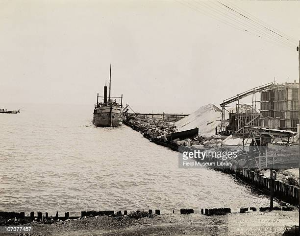 The ship LL Barth unloading supplies near sand stockpile for Field Museum construction site Chicago Illinois September 8 1916