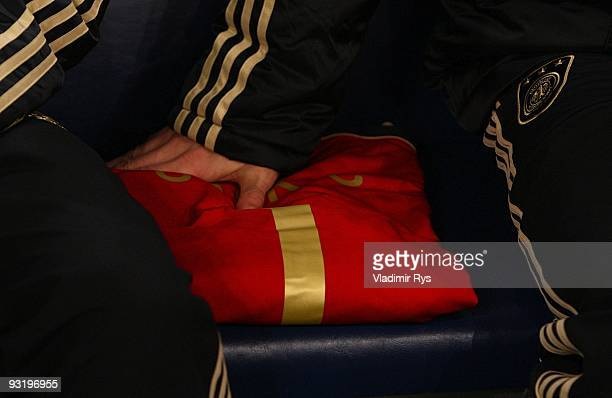 The shirt of German national goalkeeper Robert Enke is placed on the substitutes bench ahead of the during the international friendly match between...