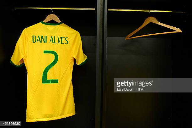 The shirt worn by Dani Alves of Brazil hangs next to an empty place for the kit of Thiago Silva of Brazil in the dressing room prior to the 2014 FIFA...