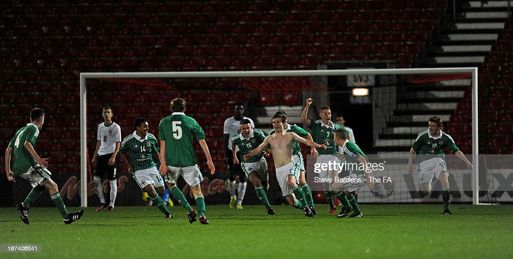 The shirtless Shea Conaty of Northern Ireland U16 celebrates scoring the winning goal with his teamates during the Victory Shield match between England U16 and Northern Ireland U16 at Goldsands Stadium on November 8, 2013 in Bournemouth, England.