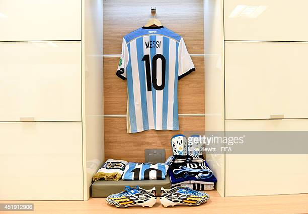 The shirts and football boots worn by Lionel Messi of Argentina and the match pennant are displayed in the dressing room prior to the 2014 FIFA World...