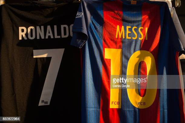 The shirts of Cristiano Ronaldo of Real Madrid CF and Lionel Messi of FC Barcelona are for sale at a stall outside the Santiago Bernabeu stadium...