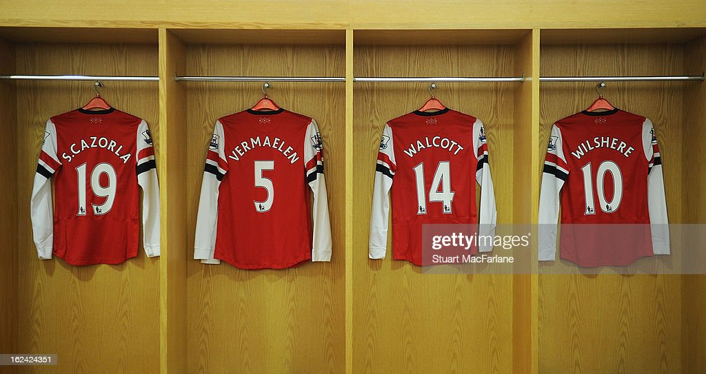 The shirts of Santi Cazorla, Thomas Vermaelen, Theo Walcott and Jack Wilshere hang in the Arsenal changing room before the Barclays Premier League match between Arsenal and Aston Villa at Emirates Stadium on February 23, 2013 in London, England.