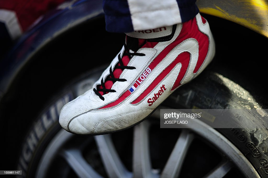 The shoe of French driver Sebastien Loeb is pictured in the technical park during the second stage of the 48th Rally of Catalonia in Salou near Tarragona, on November 10, 2012. AFP PHOTO/ JOSEP LAGO