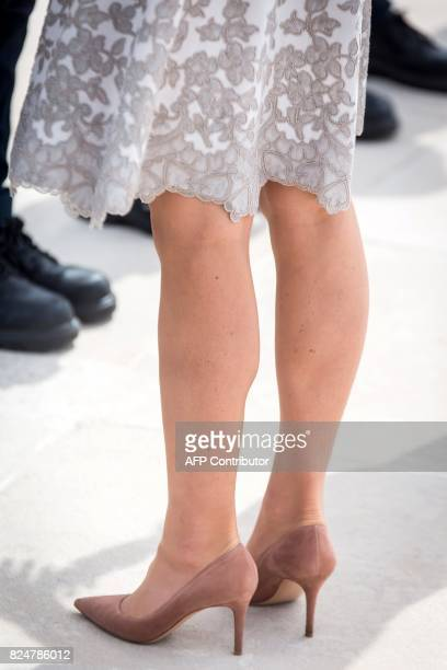 The shoes and the dress of Britain's Princess Kate the Duchess of Cambridge during a visit to the Commonwealth War Graves Bedford House on the...