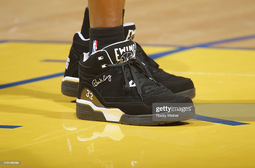 The shoes belonging to Associate coach Patrick Ewing of the Charlotte Bobcats in a game against the Golden State Warriors on February 4, 2014 at Oracle Arena in Oakland, California.