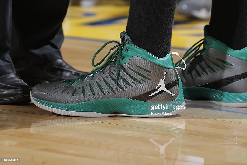The shoes belonging to <a gi-track='captionPersonalityLinkClicked' href=/galleries/search?phrase=Jared+Sullinger&family=editorial&specificpeople=6866665 ng-click='$event.stopPropagation()'>Jared Sullinger</a> #7 of the Boston Celtics in a game against the Golden State Warriors on December 29, 2012 at Oracle Arena in Oakland, California.