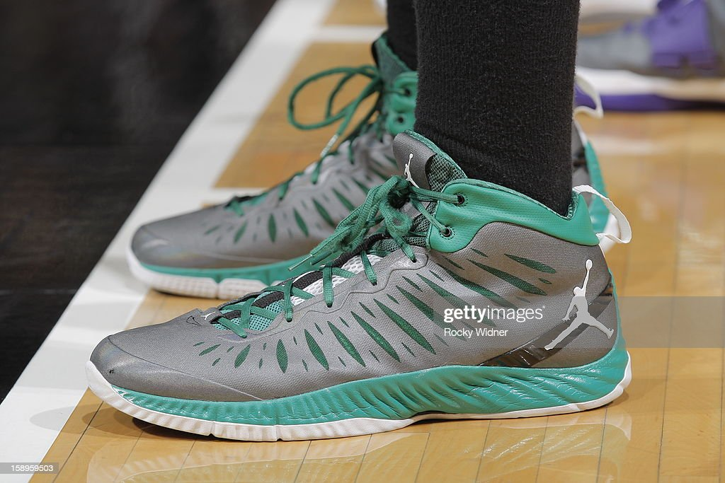 The shoes belonging to <a gi-track='captionPersonalityLinkClicked' href=/galleries/search?phrase=Jared+Sullinger&family=editorial&specificpeople=6866665 ng-click='$event.stopPropagation()'>Jared Sullinger</a> #7 of the Boston Celtics in a game against the Sacramento Kings on December 30, 2012 at Sleep Train Arena in Sacramento, California.