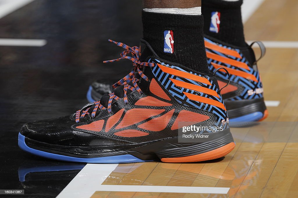 The shoes belonging to <a gi-track='captionPersonalityLinkClicked' href=/galleries/search?phrase=Serge+Ibaka&family=editorial&specificpeople=5133378 ng-click='$event.stopPropagation()'>Serge Ibaka</a> #9 of the Oklahoma City Thunder in a game against the Sacramento Kings on January 25, 2013 at Sleep Train Arena in Sacramento, California.