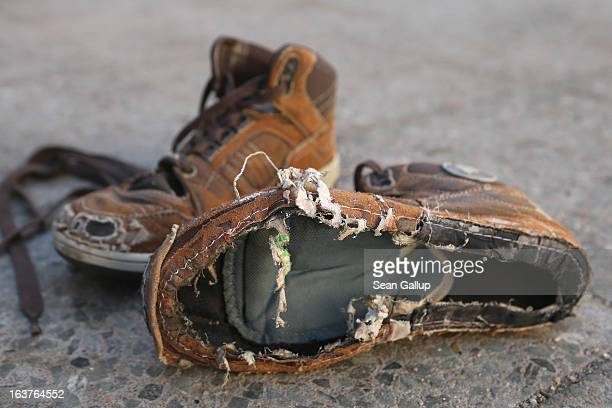 The shoes including one missing a sole of an eightyearold boy who together with his brother was found recently on a wintry evening in a city...