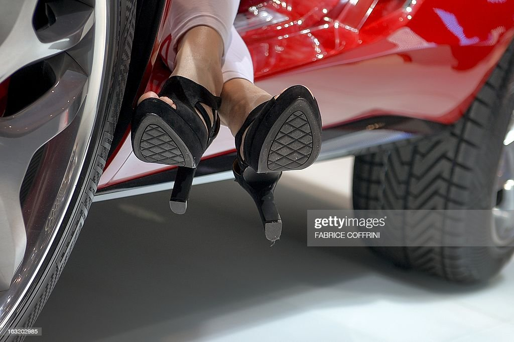 The shoes of a model are seen at the booth of Italian carmaker Giugiario at the Geneva International Motor Show on March 6, 2013. Global sales of cars, buses, utility vehicles and trucks are expected to grow three percent this year, down from five percent in 2012, according to a forecast published on March 6, 2013. The growth forecast, presented by the International Organisation of Motor Vehicle Manufacturers (OICA) at the Geneva Motor Show, is based on figures provided by the national car federations in three quarters of OICA member countries.