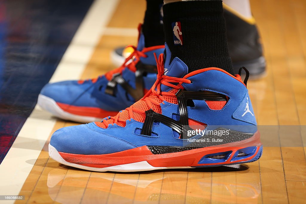 The shoes of <a gi-track='captionPersonalityLinkClicked' href=/galleries/search?phrase=Carmelo+Anthony&family=editorial&specificpeople=201494 ng-click='$event.stopPropagation()'>Carmelo Anthony</a> #7 of the New York Knicks during the game against the Indiana Pacers in Game Three of the Eastern Conference Semifinals during the 2013 NBA Playoffs on May 11, 2013 at the Bankers Life Fieldhouse in Indianapolis.