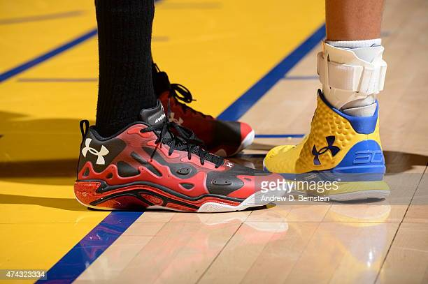 The shoes of Corey Brewer of the Houston Rockets and Stephen Curry of the Golden State Warriors are seen in Game Two of the Western Conference Finals...