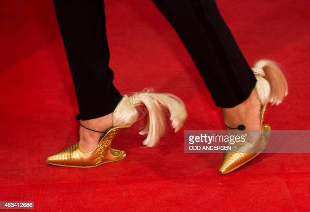 The shoes of German stylist and cat walk coach Jorge Gonzales are pictured as he poses for photographers on the red carpet during the 65th Berlin...