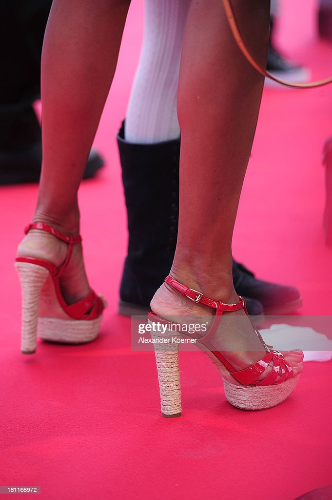 The shoes of German TV presenter Verona Pooth are seen during the red carpet prior the Ferrero kinderTag 2013 event at Heidepark on September 19, 2013 in Soltau, Germany.