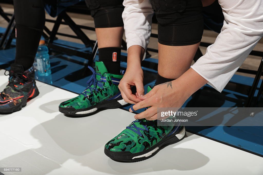 The shoes of <a gi-track='captionPersonalityLinkClicked' href=/galleries/search?phrase=Janel+McCarville&family=editorial&specificpeople=239106 ng-click='$event.stopPropagation()'>Janel McCarville</a> #4 of the Minnesota Lynx are seen before the game against the Indiana Fever on May 27, 2016 at Target Center in Minneapolis, Minnesota.