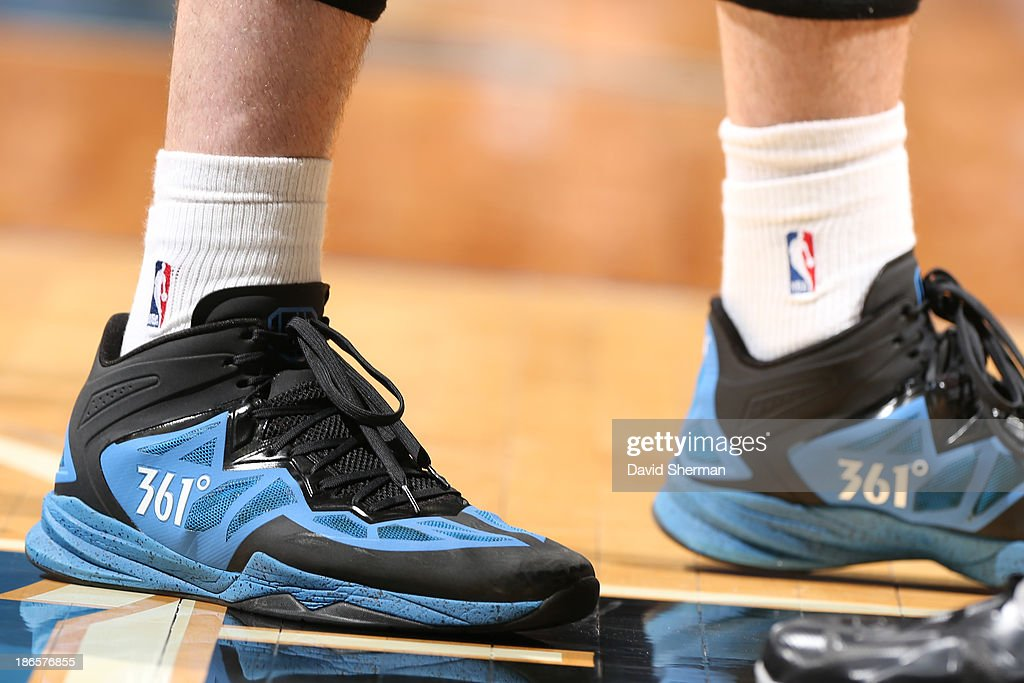 The shoes of <a gi-track='captionPersonalityLinkClicked' href=/galleries/search?phrase=Kevin+Love&family=editorial&specificpeople=4212726 ng-click='$event.stopPropagation()'>Kevin Love</a> #42 of the Minnesota Timberwolves during the game against the Orlando Magic on October 30, 2013 at Target Center in Minneapolis, Minnesota.