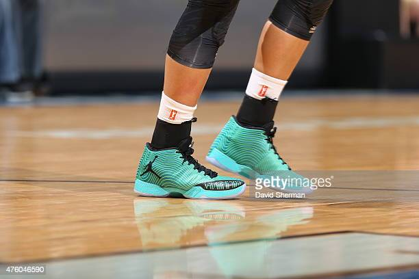 The shoes of Maya Moore of the Minnesota Lynx are seen against the Tulsa Shock during the season opener of their WNBA game on June 5 2015 at Target...