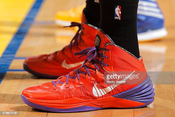 The shoes of Miles Plumlee of the Phoenix Suns during a game against the Golden State Warriors on March 9 2014 at Oracle Arena in Oakland California...