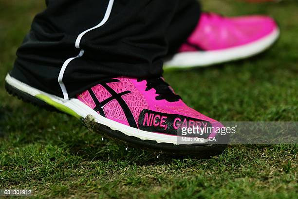 The shoes of Nathan Lyon of the Sixers are seen reading 'Nice Garry' during the Big Bash League match between the Sydney Sixers and the Melbourne...