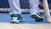 The shoes of Norichika Aoki of the Seattle Mariners as he stands outside the batting cage before a game against the Boston Red Sox at Fenway Park on...