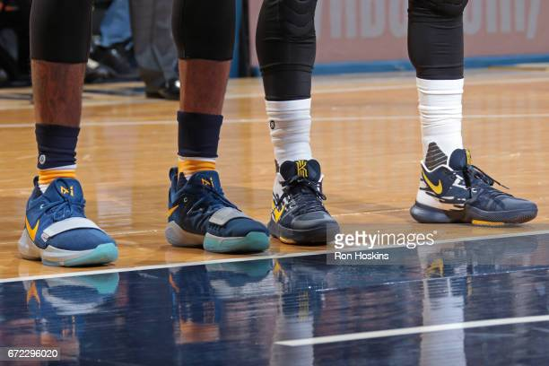 The shoes of Paul George of the Indiana Pacers and Kyrie Irving of the Cleveland Cavaliers during Game Four of the Eastern Conference Quarterfinals...