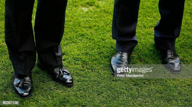 The shoes of President Nicolas Sarkozy stand on the Arsenal football club grass with Prime Minister Gordon Brown at the Emirates stadium on March 27...