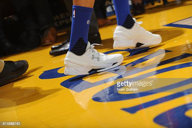 The shoes of Stephen Curry of the Golden State Warriors as he faces the Utah Jazz on March 9 2016 at Oracle Arena in Oakland California NOTE TO USER...