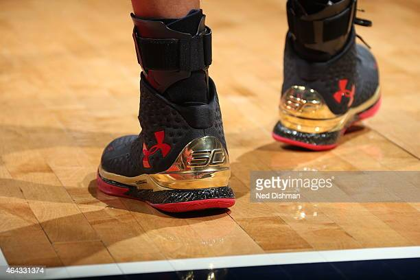 The shoes of Stephen Curry of the Golden State Warriors as he stands on the court during a game against the Washington Wizards on February 24 2015 at...