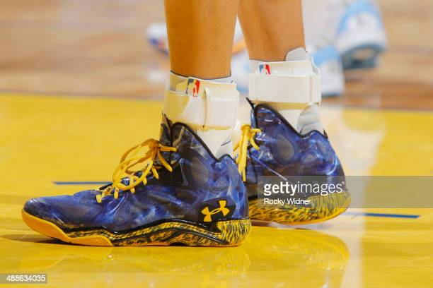 The shoes of Stephen Curry of the Golden State Warriors during a game against the Denver Nuggets on April 10 2014 at Oracle Arena in Oakland...