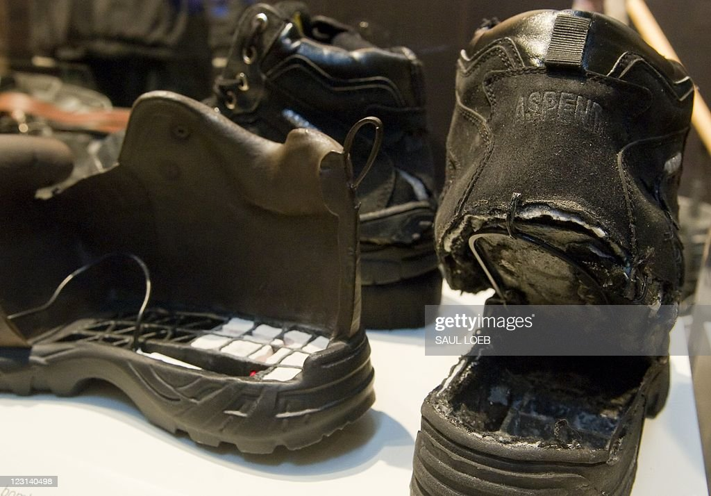 The shoes used in the failed attempt to blow up an airplane by shoe bomber Richard Reid are displayed alongside an FBI model of the shoe filled with...