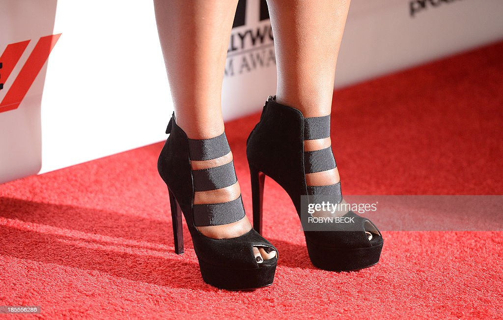 The shoes worn by actress Octavia Spencer are seen as she arrives for the the 17th Annual Hollywood Film Awards Gala, October 21, 2013 at the Beverly Hilton Hotel in Beverly Hills, California AFP PHOTO / Robyn Beck
