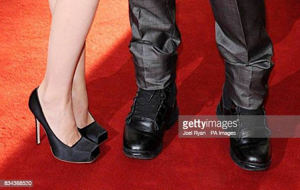 The shoes worn by Gwyneth Paltrow and Robert Downey Jr as they arrive for the UK charity premiere of Iron Man at the Odeon West End Cinema in...