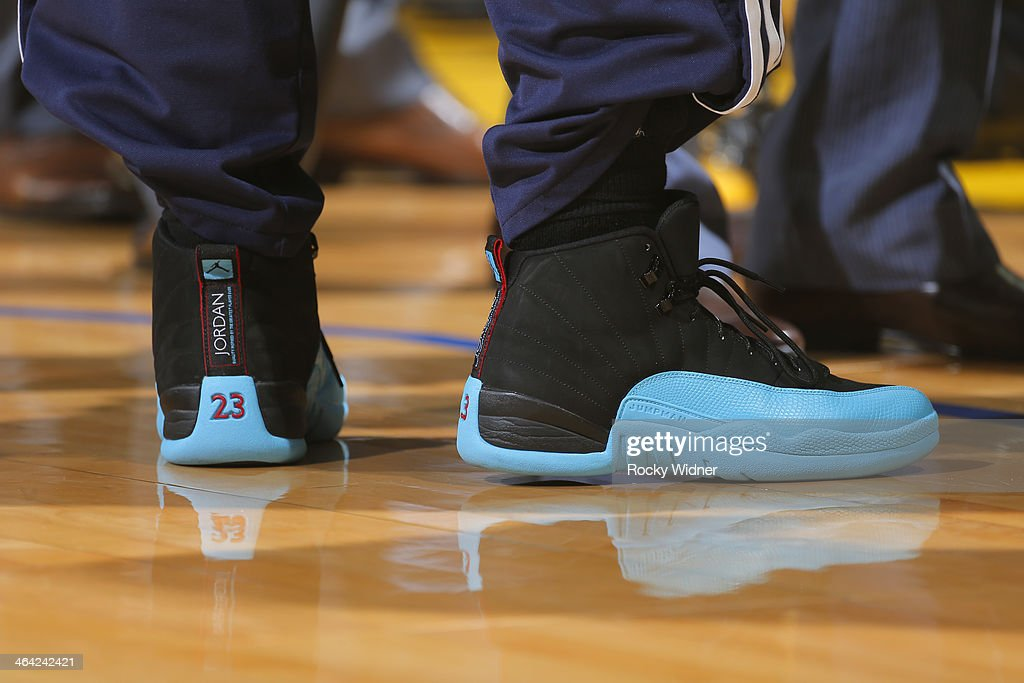 The shoes worn by <a gi-track='captionPersonalityLinkClicked' href=/galleries/search?phrase=Nate+Robinson&family=editorial&specificpeople=208906 ng-click='$event.stopPropagation()'>Nate Robinson</a> #10 of the Denver Nuggets during a game against the Golden State Warriors on January 15, 2014 at Oracle Arena in Oakland, California.