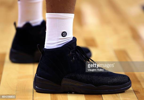The shoes worn by PJ Tucker of the Toronto Raptors during the second half of an NBA game against the Oklahoma City Thunder at Air Canada Centre on...